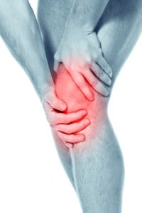 Man holding a painful left knee