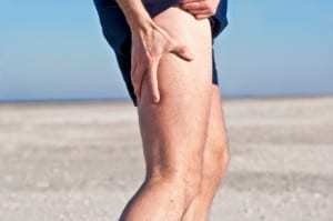 Man holding painful hamstring