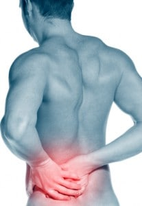 Man holding a painful back due to back knotts